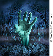 Zombie Hand Rising - Zombie hand rising out of the ground in...