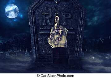 Zombie hand showing middle finger in front of tombstone, creepy cemetary in the background.