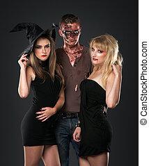 zombie vampire and witch  in the dark studio