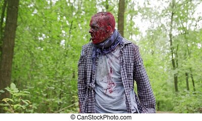 Zombies are walking through the woods. - Zombies male are...
