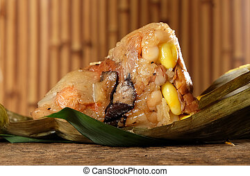 Zongzi or Traditional Chinese Sticky Rice Dumplings. - Close...