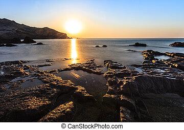 zonopkomst, op het strand
