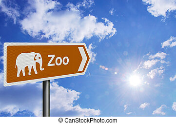 Zoo sign, against a bright blue sunny sky
