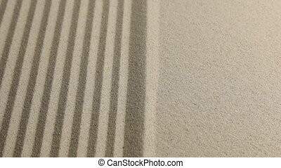 Zoom border of striped and flat sand. Strip sand background.