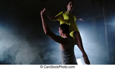 Zoom camera, two modern ballet dancers are dancing on stage...