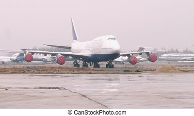 Zoom in on boeing 747 staying on parking