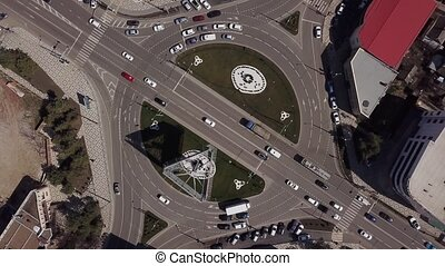 Zoom in urban road with traffic cars, top down view of...