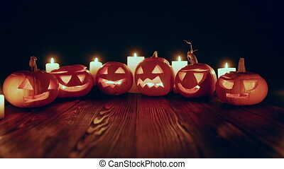 Zoom in video of Jack-o-latern Halloween pumpkins with...
