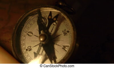 Zoom in view of the compass and the candle