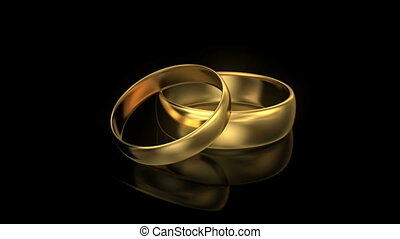 Zoom in wedding rings on black background with reflection....