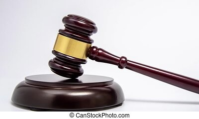 Zoom out. A wooden judge gavel on white background.