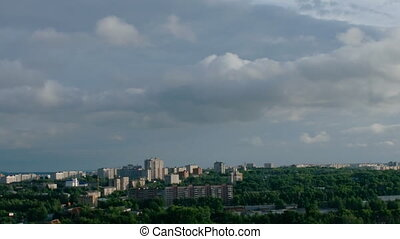 Zoom out city with cloud time lapse