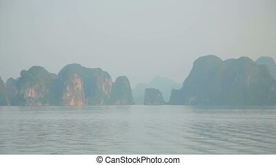 Zoom out - limestone mountain islands, Halong Bay, Vietnam