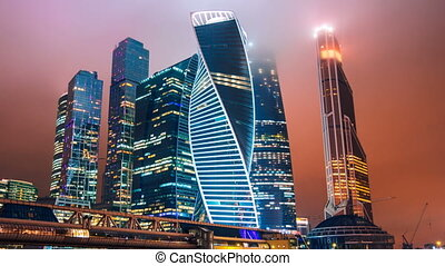 Zoom out Timelapse hyperlapse of Moscow city international business district at night