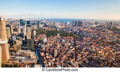 Zoom out timelapse rooftop view of Istanbul business district and Golden horn