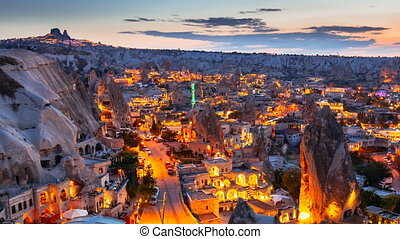 Zoom out Timelapse view of Goreme village in Cappadocia at night in Turkey