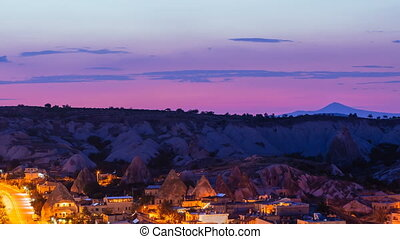 Zoom out Timelapse view of Goreme village with beautiful sky in Cappadocia at night in Turkey