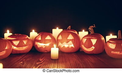 Zoom out video of Jack-o-latern Halloween pumpkins with...