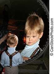 Zoom Reflection - Small boy in front of spherical mirror