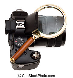 Zoom - Magnifying glass and digital camera on a white...