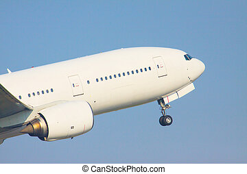 zoom up front veiw of passenger jet plane take off to flying fro