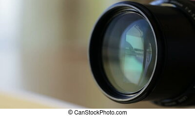 Zooming lens when shooting with camera. - Zooming the lens...