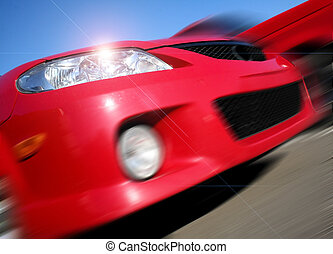 Zooming red Mazda car on a sunny day