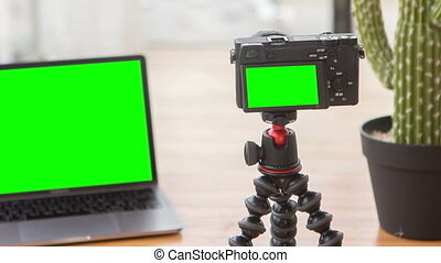Zooming out footage on camera with chromakey screen on ...