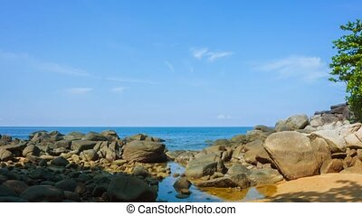 Zooming Out from Tropical Sea on Rocky Beach - Video - Slow,...