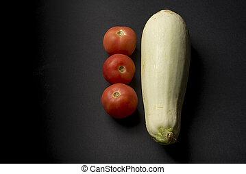 zucchini and three tomatoes