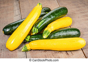 Zucchini and yellow squash on table - Zucchini and yellow ...