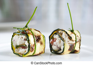 Zucchini appetizer - Two zucchini appetizers stuffed with...