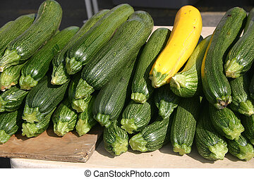 Zucchini - Golden and Green Zuchini in an outdoor market in...