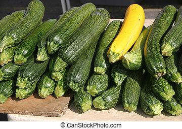 Zucchini - Golden and Green Zuchini in an outdoor market in...