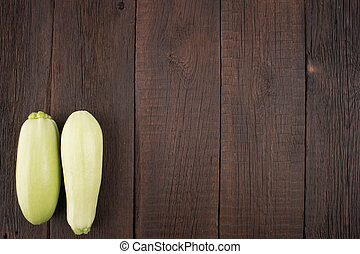 Zucchini on an old wooden table.