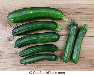 Zucchini on wooden background