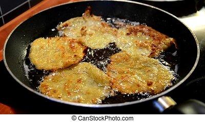 Zucchini pancake frying