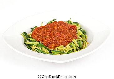 zucchini spaghetti spiral with tomato sauce over white ...