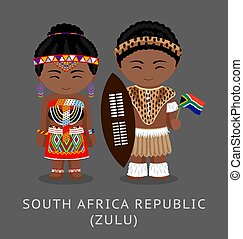 Zulu tribe. Zulus in national clothes with a flag.