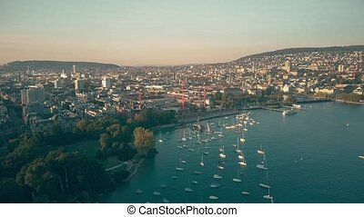 Zurich cityscape and the Limmat river outflow, aerial view -...