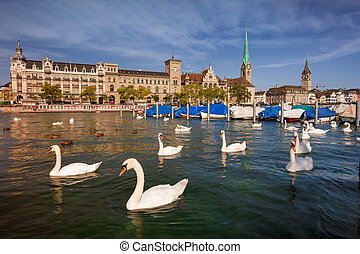 Cityscape image of Zurich, Switzerland during sunny summer morning.