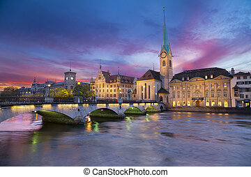 Image of Zurich, capital of Switzerland, during dramatic sunset.