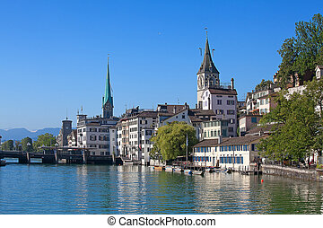 Zurich in summer - Limmat river and famous Zurich churches