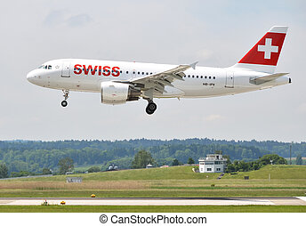 ZURICH, SWITZERLAND - MAY 25, 2014: Swiss airplane landing ...