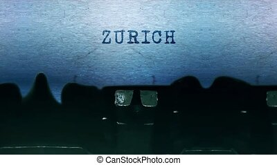 ZURICH Word closeup Being Typing and Centered on a Sheet of paper on old vintage Typewriter mechanical 4k Footage Background Animation.