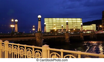 Kursaal Congress Centre in evening - Zurriola bridge over...