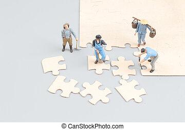 zusammenarbeiten, leute, puzzel, stichsaege, auf, stücke, besitz