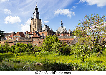 View on the St. Walburgis Church and the city wall of the historic city of Zutphen. Gelderland, The Netherlands.