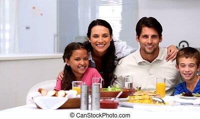 zwaaiende , het glimlachen, gezin