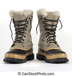 zware, de laarzen van de sneeuw